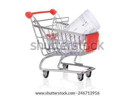 Shopping Trolley With Rolled Receipts Over White Background - stock photo