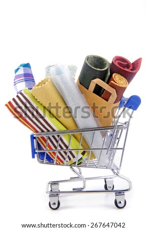 shopping trolley with various fabric materials - stock photo