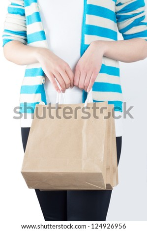 Shopping woman carrying brown paper bags - stock photo