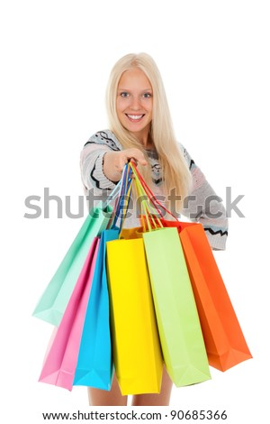 shopping woman happy excited smiling holding bags, looking at camera, wear winter knitted sweater, isolated over white background isolated on white background.