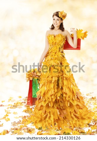 Shopping Woman Happy In Autumn Fashion Dress Of Yellow Fall Leaves With Paper Bags, Girl Spree Walking  After Autumnal Clearance Sale in Shopping Mall