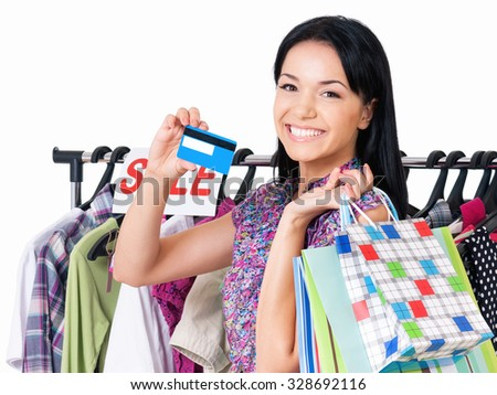 Shopping woman happy smiling holding credit card or gift card, isolated on white background - stock photo