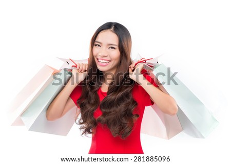 Shopping woman happy smiling holding shopping bags isolated on white background. Lovely fresh young mixed race Asian Caucasian female model. - stock photo