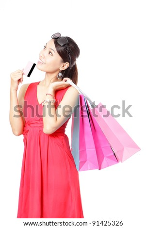 Shopping woman happy take credit card and shopping bag isolated on white background, model is a asian beauty - stock photo