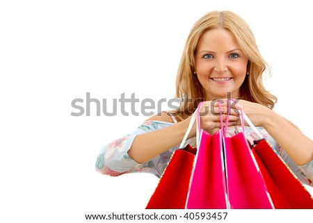 Shopping woman holding some bags in front of her face - isolated - stock photo