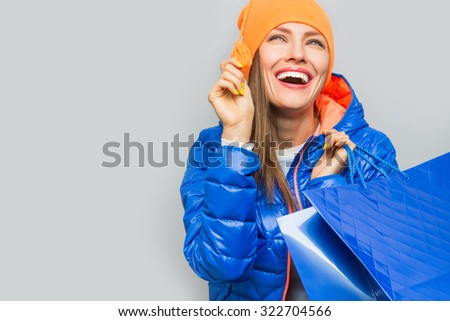 Shopping woman in autumn colors - stock photo