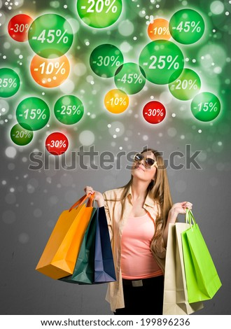 Shopping woman looking  at labels discounts percent - stock photo