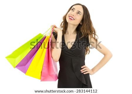 Shopping woman thinking - stock photo