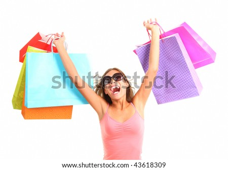 Shopping woman very excited. Shopping. Dynamic picture of young woman on a shopping spree with lots of bags. - stock photo