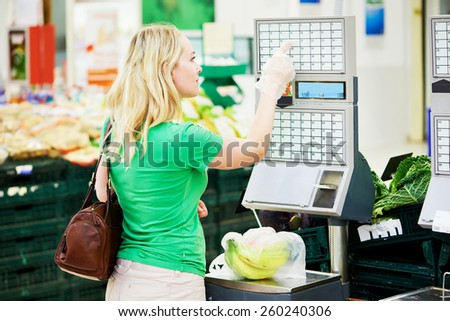 Shopping. Woman weighting banana fruits bio food in vegetable store or supermarket - stock photo