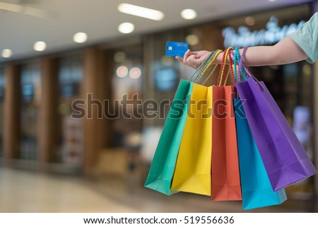 Shopping woman with bags and a credit card
