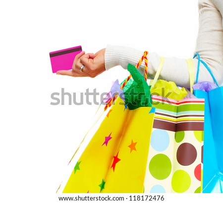 Shopping woman with bags and a credit card isolated on white background. - stock photo