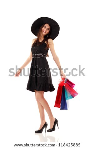 shopping young woman smiling holding bags full-length isolated on white background