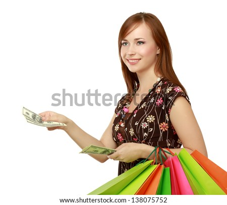 Shopping - young woman with bags and money, isolated on white background