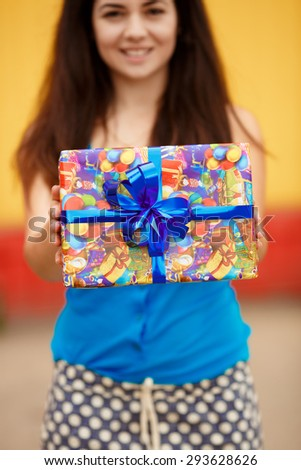 Shopping young woman with gift boxes at supermarket, happy girl with birthday present at shopping mall at sales, smiling female at birthday party with gifts, instagram style color filter,series - stock photo