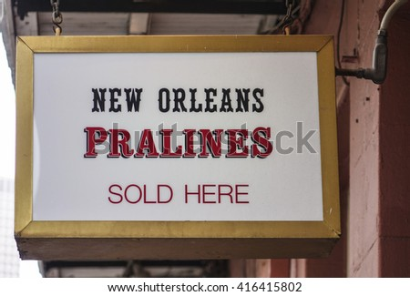 Shops and Bars in New Orleans French Quarter area - NEW ORLEANS, LOUISIANA - APRIL 18, 2016  - stock photo