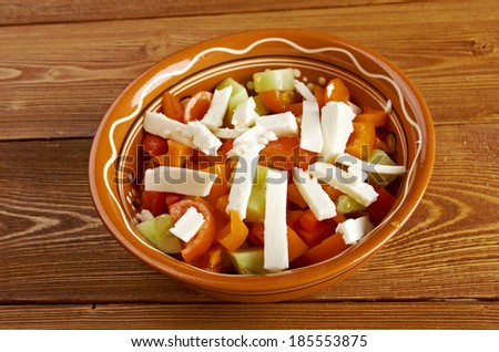 Shopska salad - also known as Bulgarian , Macedonian,Serbian; Bosnian and Croatian salad.made from tomatoes, cucumbers, onion/scallions, raw or roasted peppers, sirene