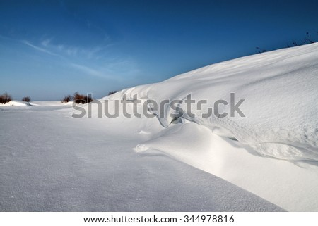 Shore of the lake covered with snow - stock photo