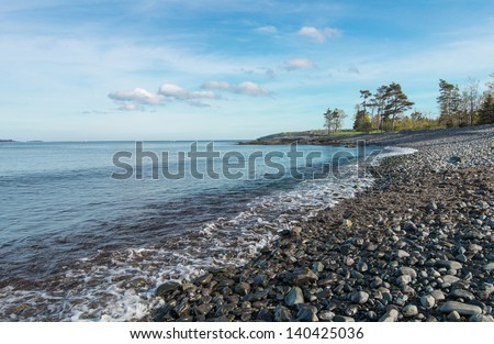 Shore scene full of pebbles in the coastline (Point Pleasant Park, Nova Scotia) - stock photo