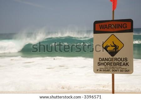 shorebreak warning on hawaii beach - stock photo
