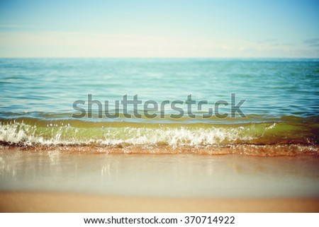 shoreline front view shallow depth of field stylized filter - stock photo