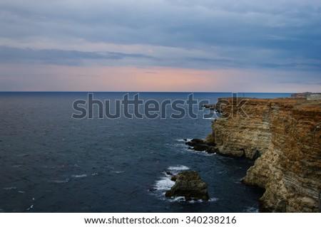shoreline of rocky cape Fiolent in sunset light, Black sea, Crimea, Russia - stock photo