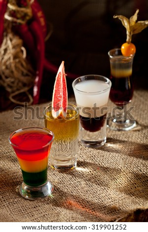 Short Alcoholic Cocktail on the Sackcloth - stock photo