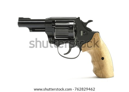 Short-barreled revolver with wooden handle isolated