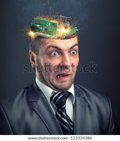 Short circuit in businessman computer brain - stock photo