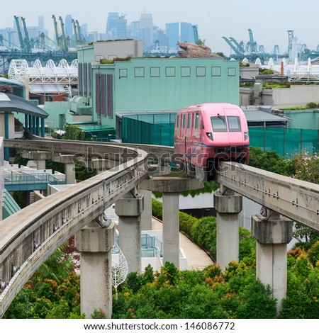 Short monorail train in bright pink flower, Sentosa island, Singapore - stock photo