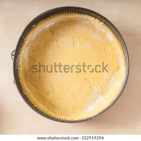 Short pastry case in oven tray (top view)  on wood - stock photo