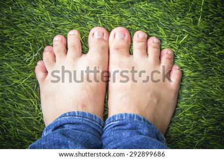 Short toes on grass backgrond - stock photo