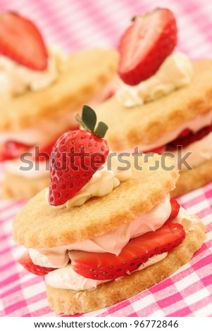Shortbread biscuits/cookies with a strawberry and cream filling. - stock photo