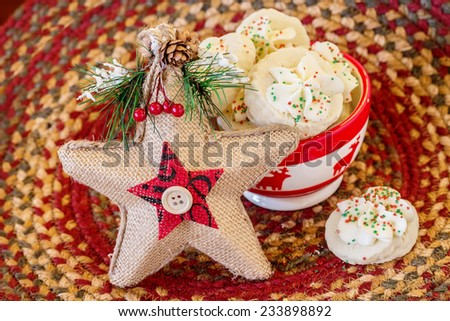 Shortbread cookies in a Christmas themed bowl.