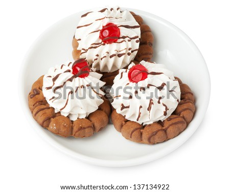 Shortbread cookies with cream and berry jelly and cherry on plate isolated on white background