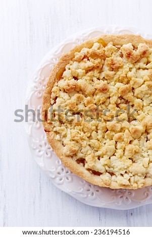 Shortcrust apple tart with coconut crumble  - stock photo