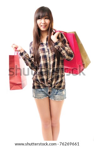 Shorts with a shopping bag of beautiful young girls in white background.full length.Asian Caucasian ethnicity. - stock photo