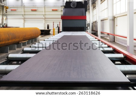 Shot blasting machine for processing of metal plates and profiles. Focus on the edge of metal plate - stock photo