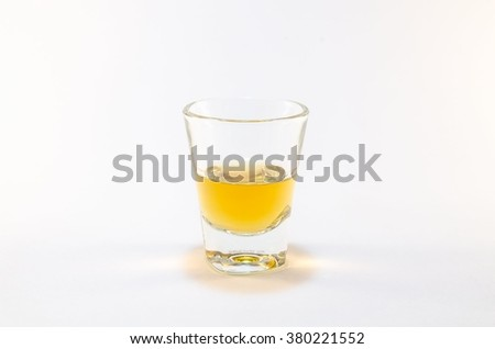 shot glass whiskey on white background