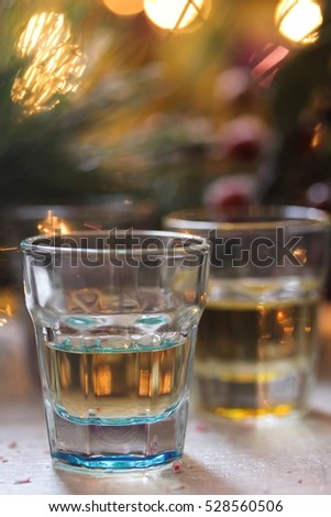 Shot glasses on Holiday Xmas background, selective focus