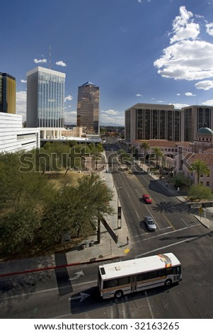 Shot looking down Church Avenue on a clear day in downtown Tucson Arizona, bus turning in foreground.