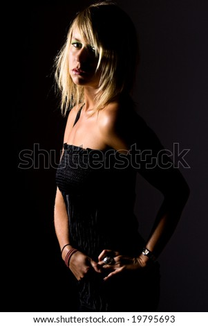 Shot of a Beautiful Blonde Girl Looking Sultry - stock photo