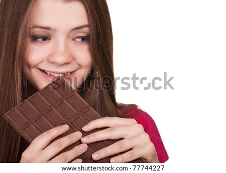 Shot of a beautiful teen girl holding big chocolate bar