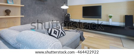 Shot of a cozy living room with a comfortable sofa and a TV