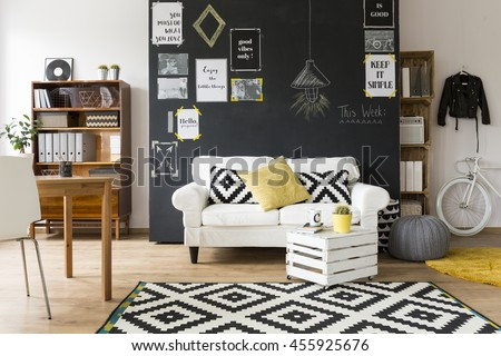 Shot of a creative and comfortable living room interior  - stock photo