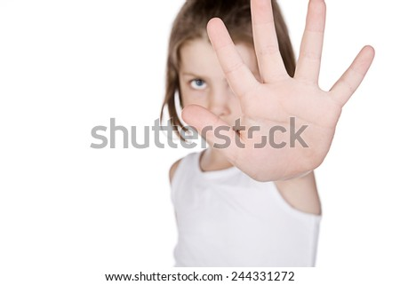 Shot of a Cute LIttle Girl Hiding Behind her Hand - stock photo