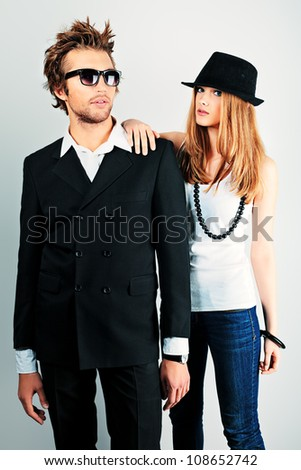 Shot of a fashionable couple posing at studio.