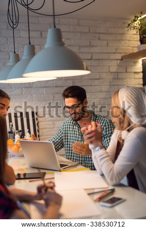 Shot of a group of designers working on their project. - stock photo