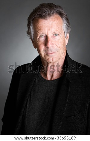 Shot of a Handsome Senior Man against a Grey Background - stock photo