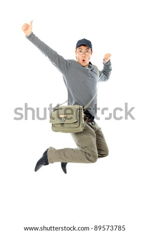 Shot of a happy jumping young man. Isolated over white background. - stock photo